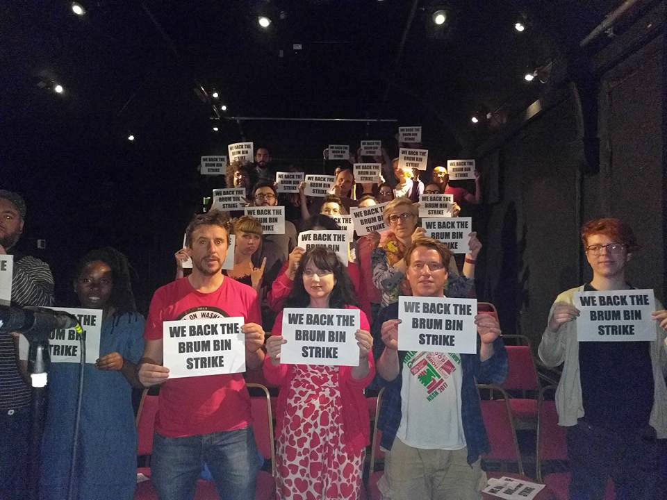 Audience and acts send solidarity to striking Birmingham bin workers from the Bad Art Protest Showcase in Leicester 2017